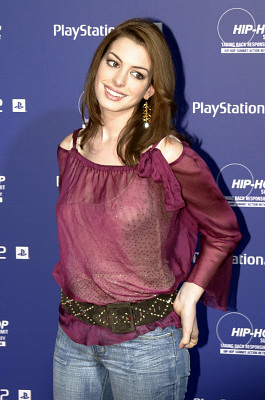Anne Hathaway in jeans and sheer red top