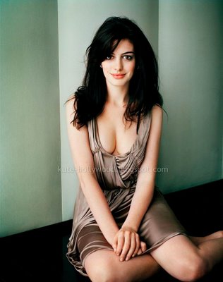 Anne Hathaway - proud of her ample cleavage in tan satin dress