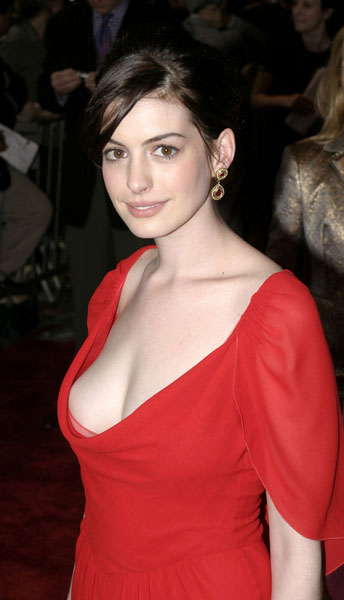 Anne Hathaway showing lots of cleavage in lowcut red dress Anne Hathaway