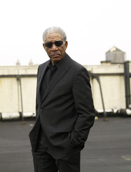 Morgan Freeman in black suit with sunglasses